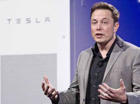 "Elon Musk, co-founder and chief executive officer of Tesla Motors Inc., speaks during the unveiling of the company's ""Powerwall' at an event in Hawthorne, California, U.S., on Thursday, April 30, 2015. Musk unveiled a suite of batteries to store electricity for homes, businesses and utilities, saying a greener power grid furthers the company's mission to provide pollution-free energy. Photographer: Tim Rue/Bloomberg via Getty Images"