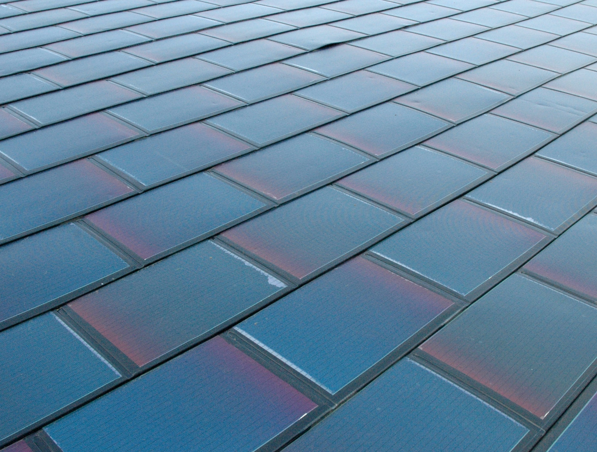 Tesla Solar Roof Shingles >> Elon Musk leads effort to build house roofs entirely out ...